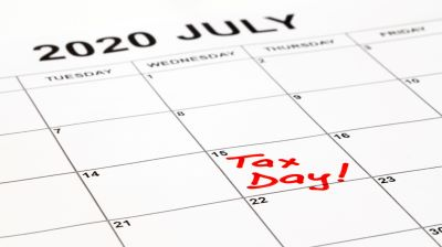 Taxes due date is set for 17th May 2021 due to corona virus outbreak. Calendar page with Tax Day written in red, remainder to pay taxes. Filling and payment was extended by the government.
